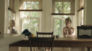 Juno Temple as Iris and Julia Garner as Catherine in ONE PERCENT MORE HUMID. Photographer: Andreas Burgess.